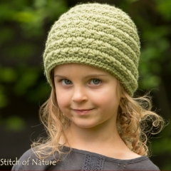 The Odessa Messy Bun Hat crochet pattern by Stitch of Nature